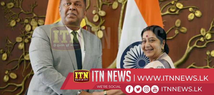 Minsters Mangala Samaraweera and Sushma Swaraj meet