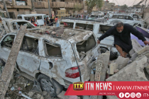 Aftermath of Baghdad explosion which killed at least 18
