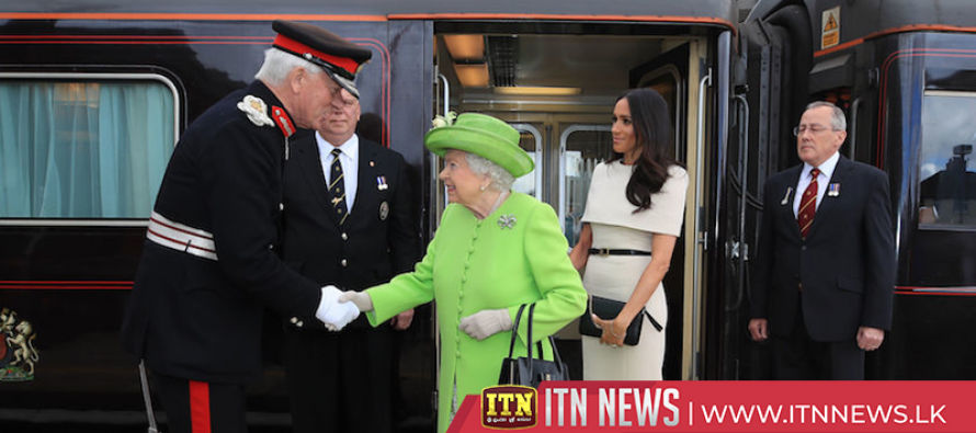 Britain's Queen Elizabeth and Meghan arrive in Cheshire by train