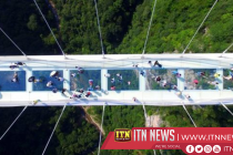 World's largest glass bridge opens in south China