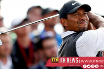 Woods charges into contention with third-round 66 at Carnoustie