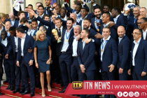 Macron and Les Bleus sing at the Elysee after victory parade