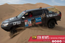 Drivers race through sand dunes in Silk Way Rally