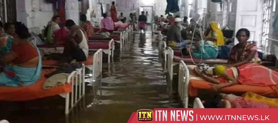 Fish swim in flood waters in Indian hospital after heavy rains