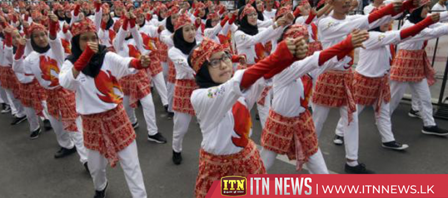Thousands attempt to break world record with Indonesian line dance ahead of Asian Games