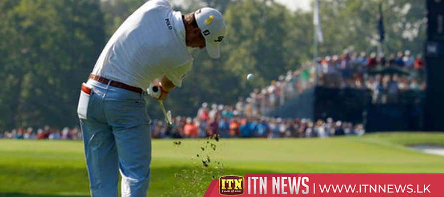 Heavy rain halts play at PGA Championship with Woodland atop leaderboard