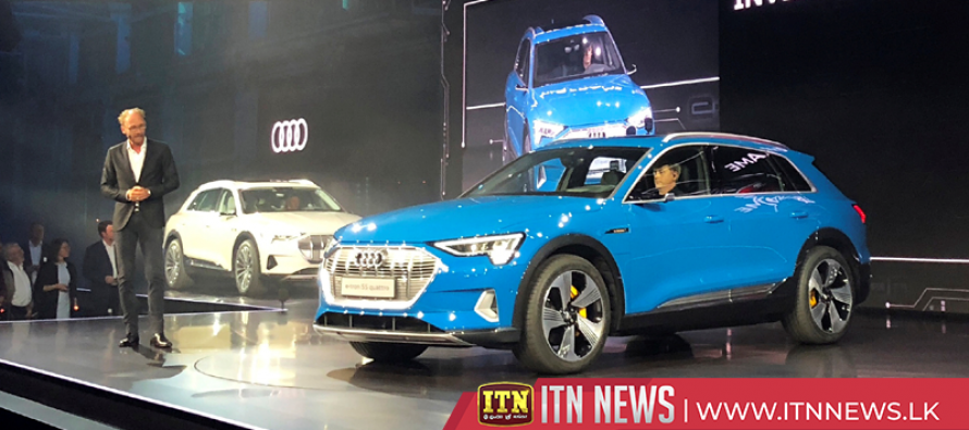 Audi launches electric SUV in Tesla's backyard