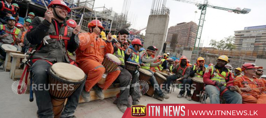 Chilean construction workers play drums to avoid stress at their workplace