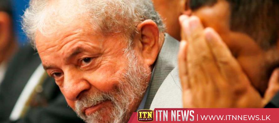 Brazil's jailed former leader Lula ends presidential bid
