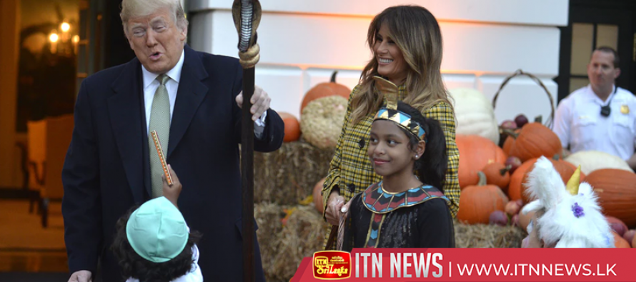 Trump and First Lady Melania hand out candy at White House Halloween celebration
