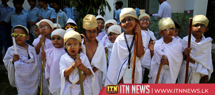 Indian children dress as Gandhi to mark 150th birthday of independence leader