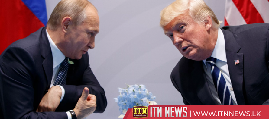 Trump says he will probably meet with Putin in Paris