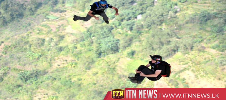 Skydivers jump from 370-meter-high bridge in southwest China
