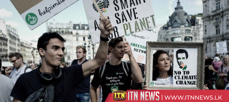 Thousands march in Geneva, urging drastic action climate change