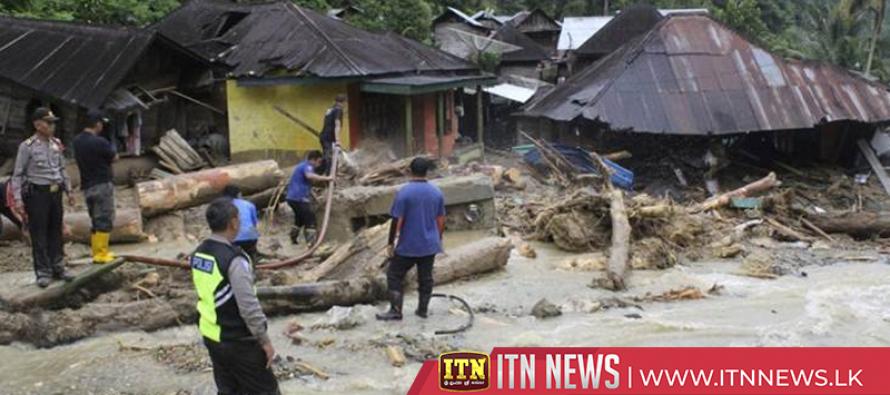 Indonesia flash floods, landslides kill at least 21