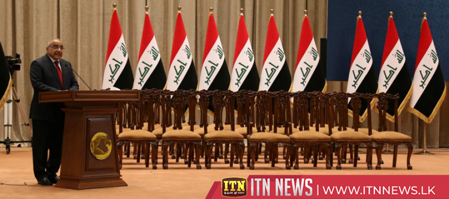 Iraq PM sworn in with partial cabinet as lawmakers disagree