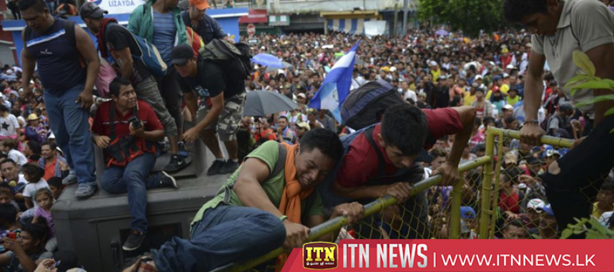 Migrant caravan pours out of Guatemala into Mexican police wall