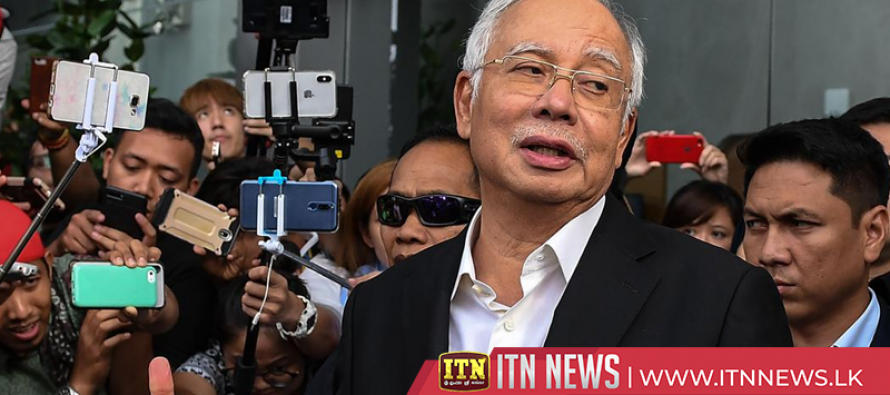 Ex-Malaysian PM attends hearing while wife is charged with money laundering