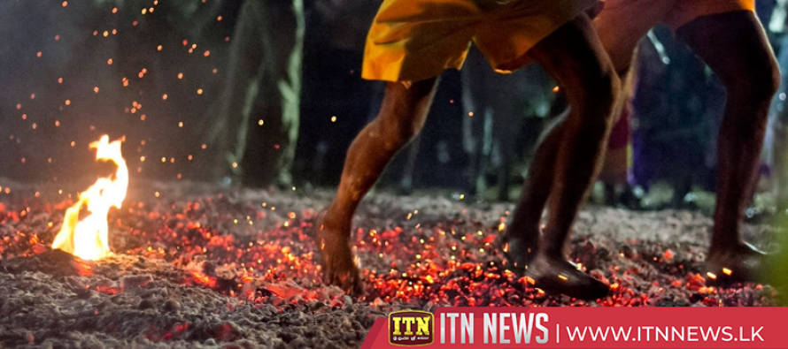 Hindu devotees walk on fire at India's Theemithi festival