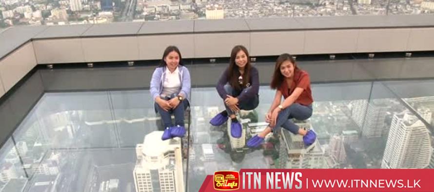 Walking on glass: Bangkok's rooftop skywalk wows thrillseekers