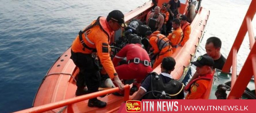 Indonesian TV shows divers bringing crashed jet's black box to boat