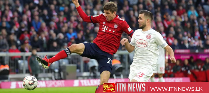 Dusseldorf stuns Bayern with stoppage-time equaliser