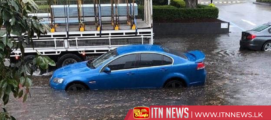 Torrential rain lashes Sydney causing flash flooding