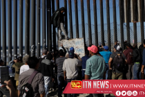 Migrants spill out onto the streets of Tijuana as shelters fill up