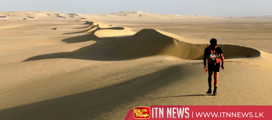 Runners feeling the heat in Oman Desert Marathon