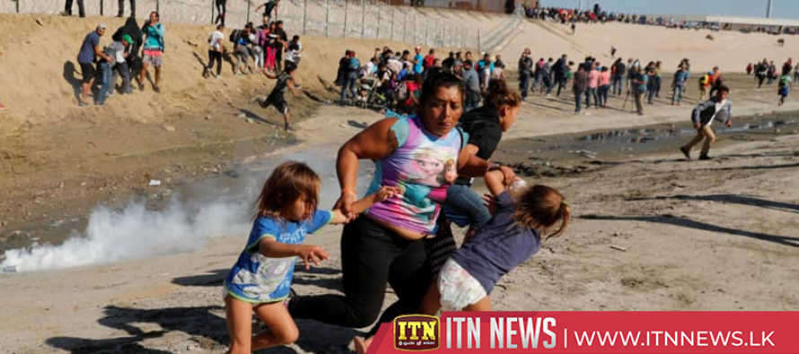 Migrant families jump Tijuana border fence, head to U.S.