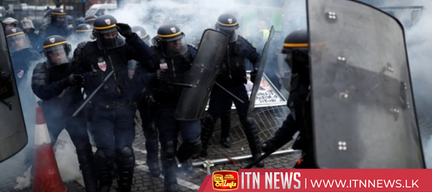 Tear gas fired in clashes in Paris