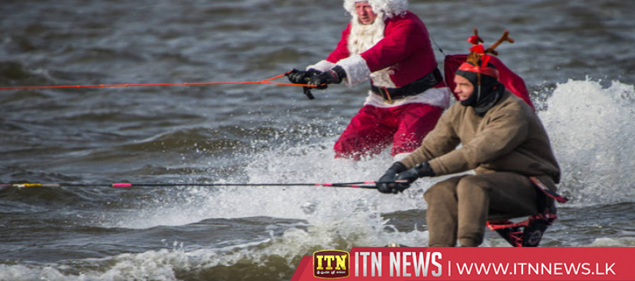 Grinch steals Santa water skiing show