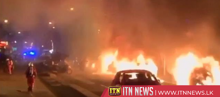 Cars ablaze outside France's Le Parisien newspaper building