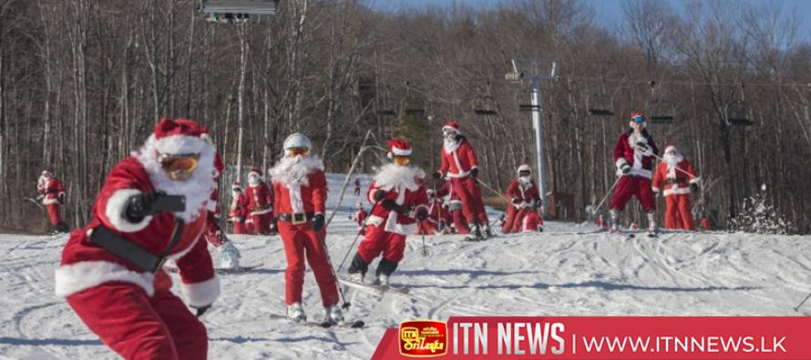 Hundreds of skiing Santas bring holiday cheer to the slopes of Maine