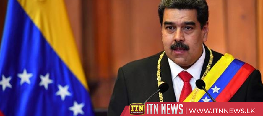 As nations turn on Maduro, Venezuela leader parades with military