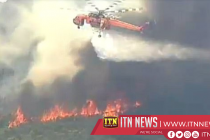 Residents and pets evacuate as Australia bushfires rage; waterbombing aircraft crashes
