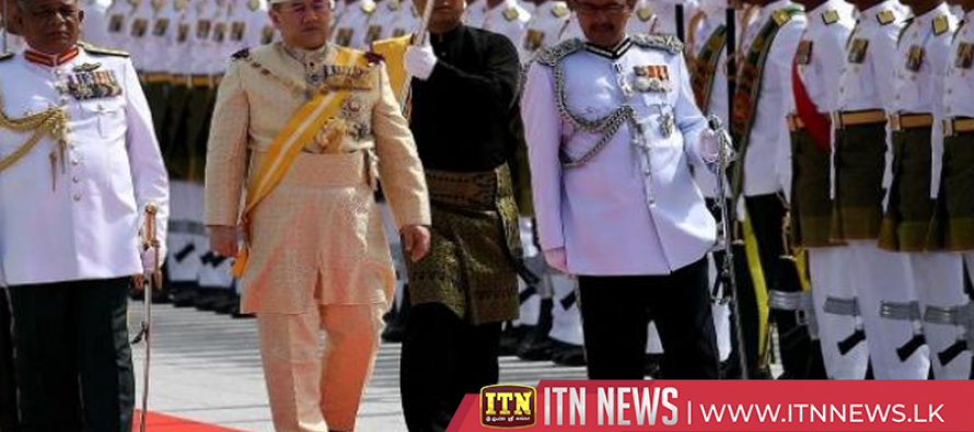 Malaysia's new king inspects honour guards, to formally take the throne