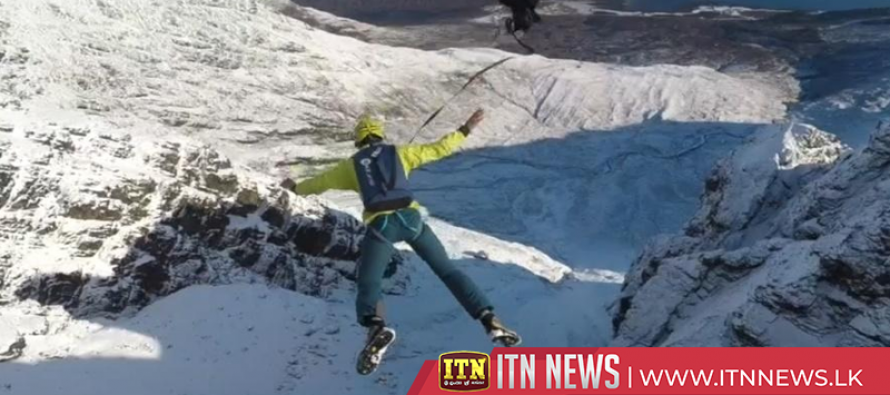 Daredevil BASE jumper performs outrageous mountain leaps