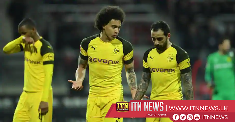 Dortmund slip up again with draw at bottom club Nuremberg