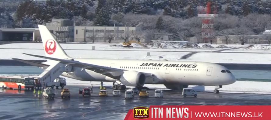 Plane skids off tarmac, closing part of Japan's main aviation hub