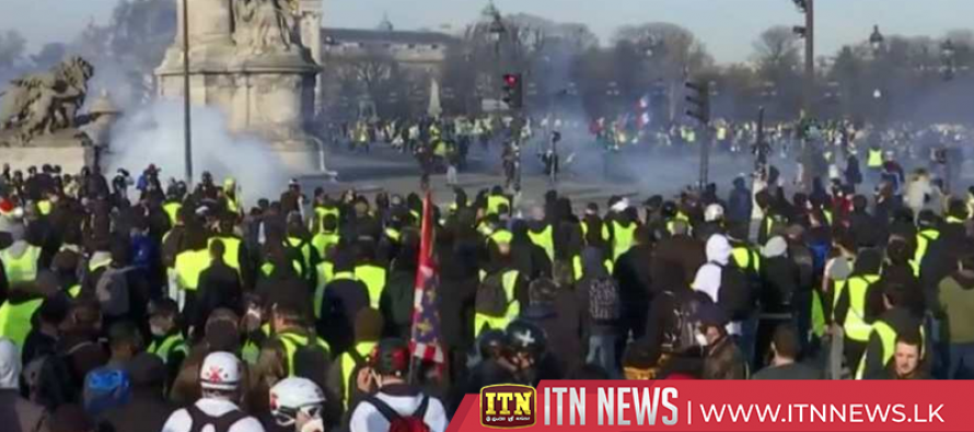 French police fire tear gas as latest Paris 'yellow vest' protests turn violent