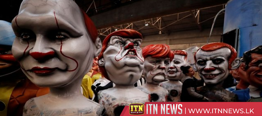 Clown-faced politicians and cinema mix at Nice Carnival