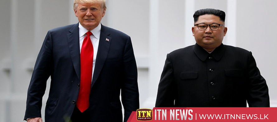 Trump and Kim greet media on second day of summit