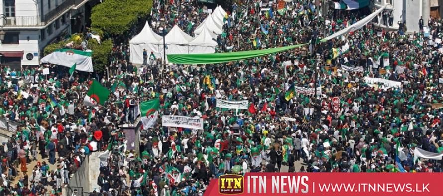 Hundreds of thousands march against Algeria's Bouteflika