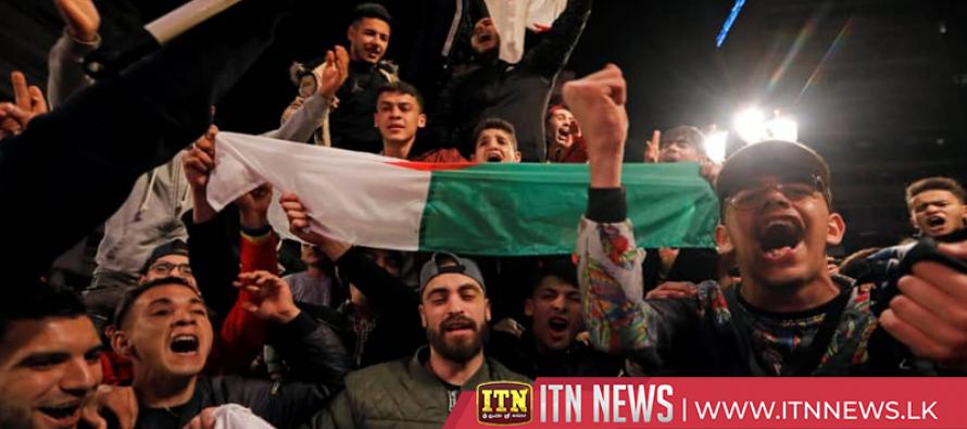 Crowds celebrate after Bouteflika abandons re-election bid