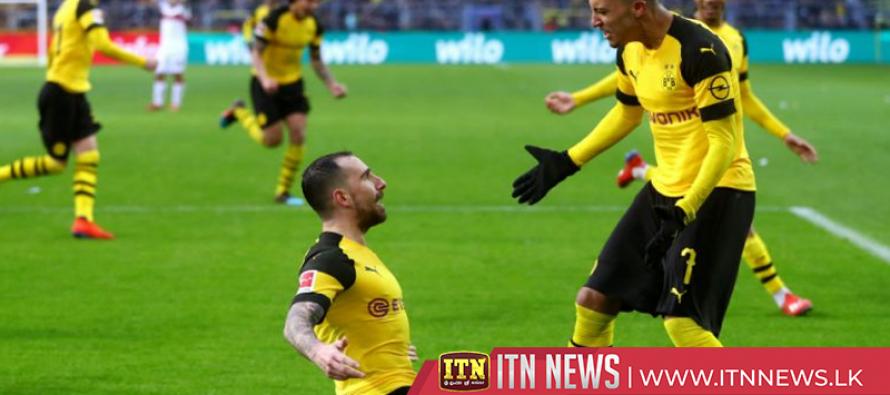 Dortmund beat Stuttgart 3-1 but lose league lead to Bayern