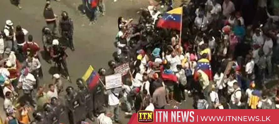 Venezuelan protesters face off with police at Caracas rally