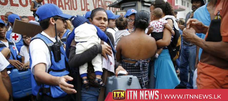 Humanitarian aid is distributed in Venezuela by the Red Cross