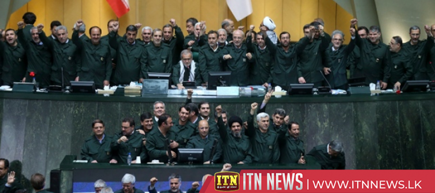 Iran's lawmakers wear Revolutionary Guards' uniforms to Parliament