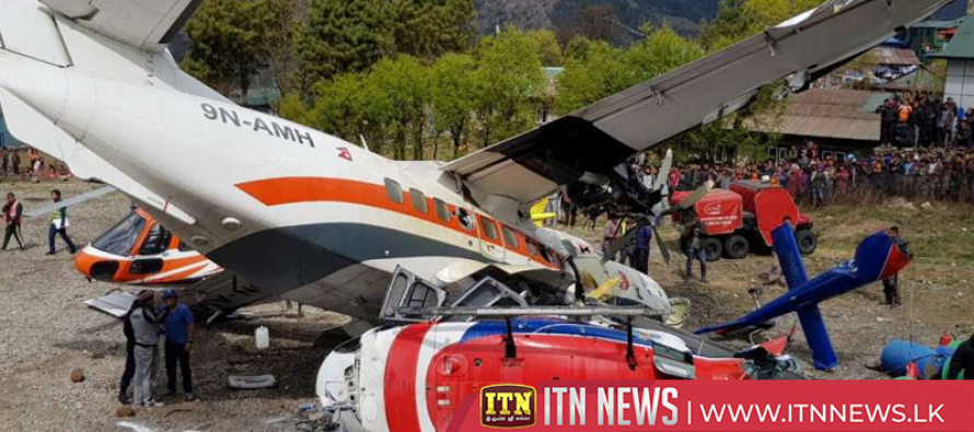 Nepal plane hits parked helicopter while taking off, killing three